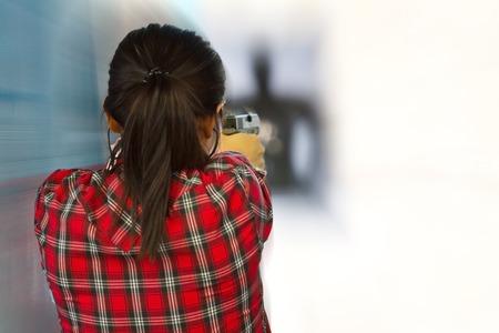 Target practicing with gun In the shooting range Standard-Bild
