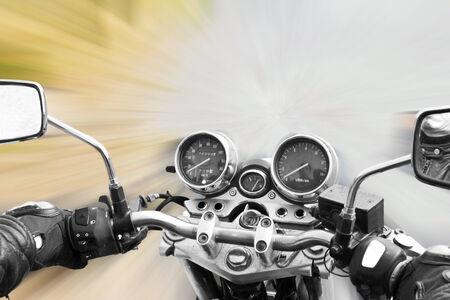 motorbike rides on the street photo