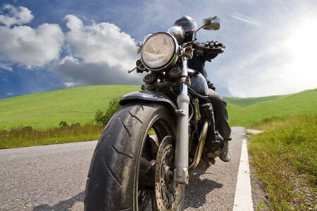 cruiser bike: Low angle view of man riding bike against clear sky Stock Photo