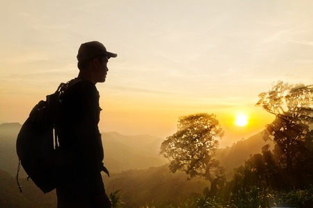 Mans silhouette at a viewpoint overlooking central Thailand