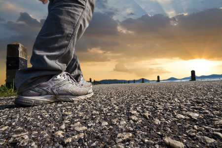 Man walking on the road with relax mood. Desert road Stock Photo