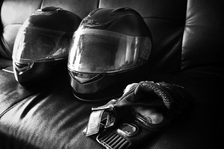 helmet and leather gloves on sofa photo