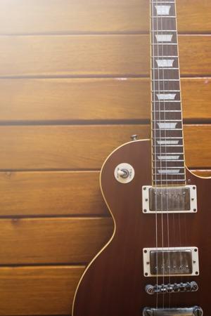 guitar case: Sunburst Electric Guitar Laying in a Hard Shell Electric Guitar Case Stock Photo