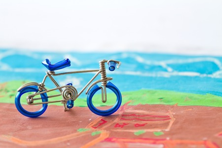 sideways: Closeup figure bicycle model with soft focus, vintage style. Stock Photo