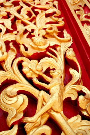 Wood carving patterns on the wooden doors of Thailand from Phuket. photo