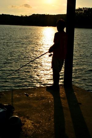 A distraught young man fishing at Rawai Beach, Phuket, Thailand Stock Photo - 8055669