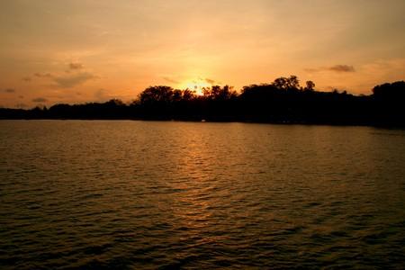 Sunset light orange at Rawai Beach, Phuket, Thailand photo