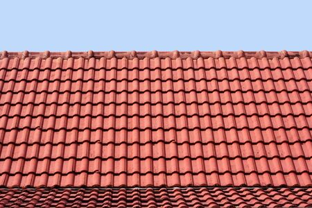 Patterned red roof light blue, blue sky. photo