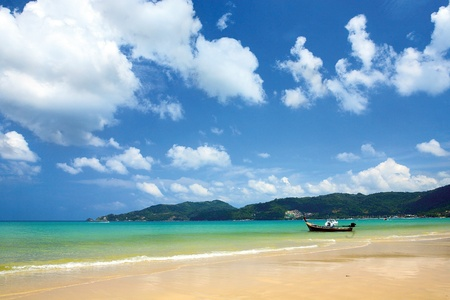 Sea view of Patong beach. A boat on Patong beach. Stock Photo