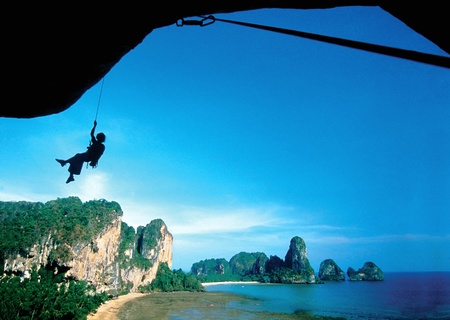 adventure travel: Silhouette of rock climbing in nature.