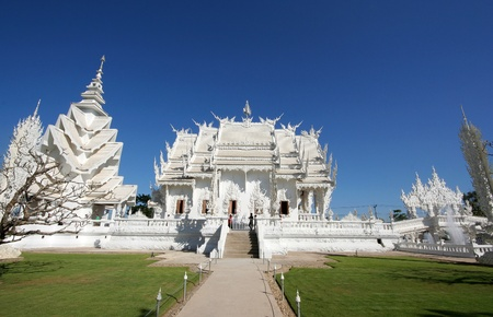 Wat Rong Khun in Chiang Rai,Thailand. Main chapel and pavilion of famous Wat Rong Khun (White temple) in Thailand