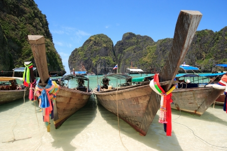 Long Tail Boat at Maya Bay, Krabi, Thailand  Crystal Clear Waters, Clear Skies and Perfect Scenery  A long tail boat sits in Maya Bay, Koh Phi Phi Ley, Thailand  The place where the movie the Beach was filmed