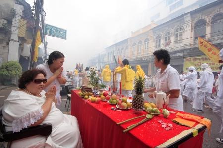 palanquin: People worship the parade  Phuket Vegetarian Festival 2012  Photo taken on  October 18th, 2012
