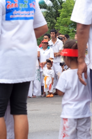 god walking: Worshippers waiting for the street procession during the Vegetarian Festival October 19, 2012 in Phuket, Thailand.