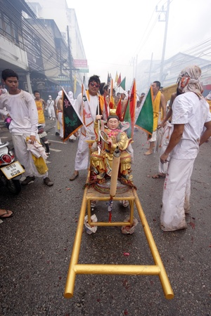 lunar month: PHUKET, THAILAND - OCTOBER 19 : the ninth lunar month of the Chinese calendar starts the Vegetarian Festival October 19, 2012 in Phuket, Thailand. Participants in the festival perform acts of body piercing as a means of shifting evil spirits from individu