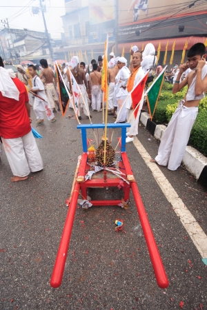 palanquin: PHUKET, THAILAND - OCTOBER 19 : the ninth lunar month of the Chinese calendar starts the Vegetarian Festival October 19, 2012 in Phuket, Thailand. Participants in the festival perform acts of body piercing as a means of shifting evil spirits from individu