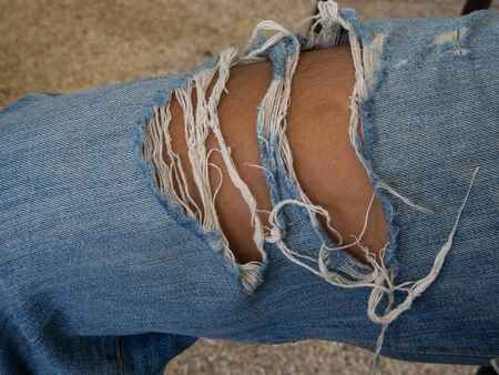 full of holes: Blue jeans full of holes Stock Photo