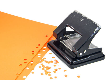 puncher: Hole puncher and confetti isolated on white. Stock Photo