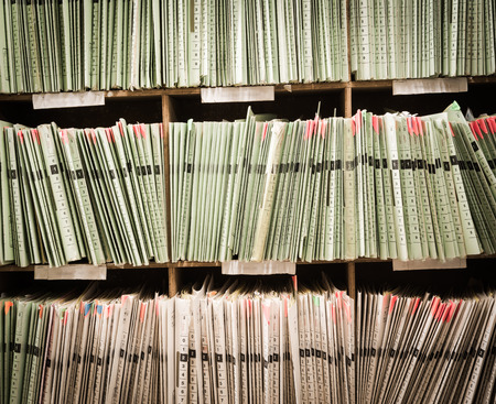 medical practice: Rows of files in a medical office Stock Photo