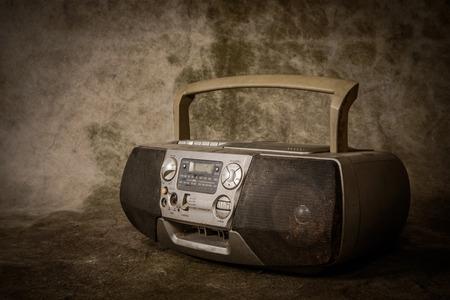 the still life retro ghetto blaster on grunge background