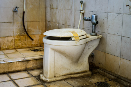 dirty old toilet bowl