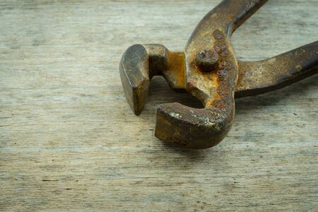 wire cutter: wire cutter on wooden background, close up