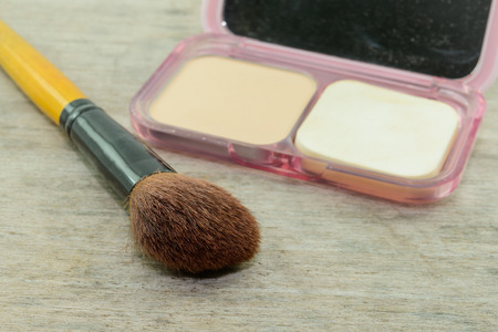 powder puff: brushes,powder, puff on wood table