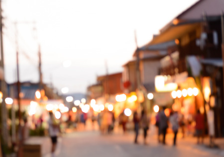 street market: Blurred crowd walking on the street, night market - can be used as abstract blur background