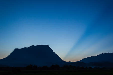 Mountains and blue light rays photo