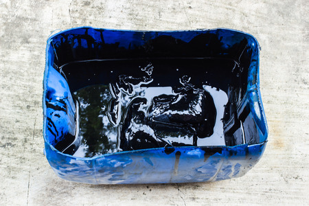Black oil in a blue barrel photo