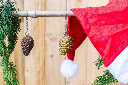 Pine cones hanging on a rope with wooden background. photo