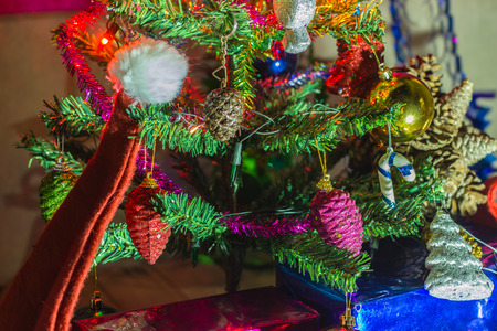 Beautifully decorated Christmas tree with many presents under it. photo