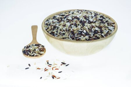 product mix: Mix rice on wooden spoon in a wooden bowl. Product of Thailand, Asia.