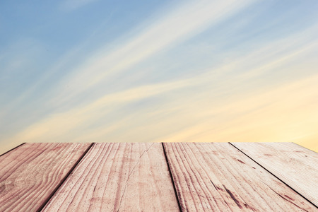 wood background: Sky gradient from blue to orange sunset