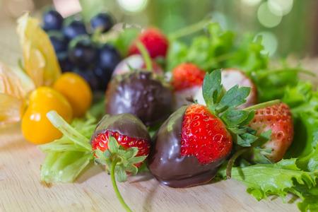 chocolate covered strawberries: Gourmet Chocolate Covered Strawberries for Valentines Day with fruit. Stock Photo