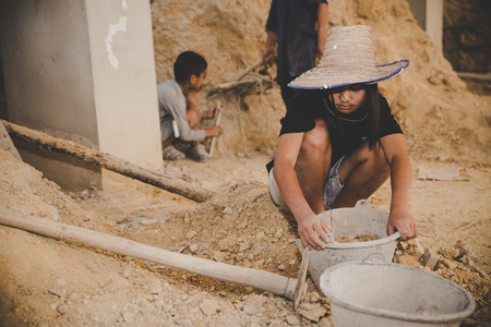 Little boys and girls labor working in commercial building structure, World Day Against Child Labour concept.