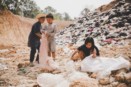 Poor children collect garbage for sale,, the concept of pollution and the environment,Recycling old rubbish,World Environment Day Stock Photo