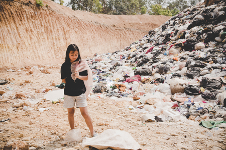 Poor children collect garbage for sale, the concept of pollution and the environment, Recycling old rubbish,World Environment Day