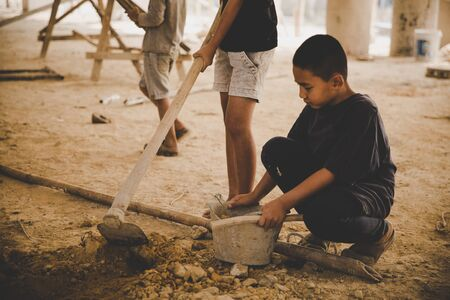 Against child labor, Poor children, construction work, labor work in the construction site,  Violence children and trafficking concept