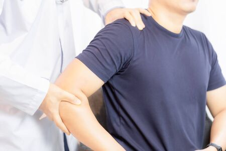 Close up of Physiotherapist working with patient in clinic