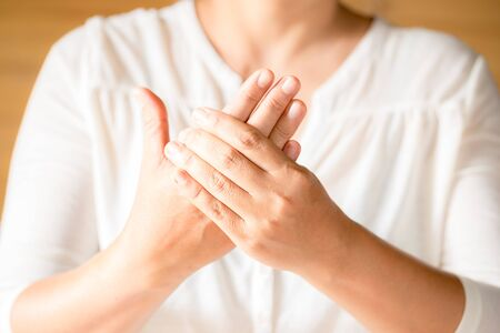 Close up woman holding her finger symptomatic Office Syndrome. Health-care concept