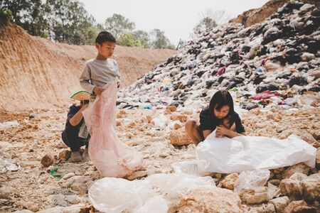 Poor children collect garbage for sale, the concept of pollution and the environment, Recycling old rubbish, World Environment Day