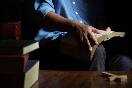 Bible on wooden background. Symbol of spirituality. World religion. 写真素材