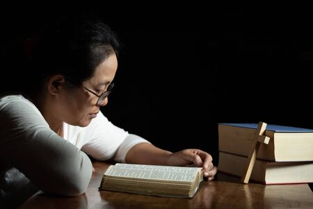 Christian women read the scriptures in the house with two books with a cross on the side of the book placed on the table. 写真素材