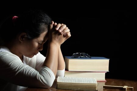 Religious concepts Hand praying to God Human hands pray for blessings from God. Stock Photo
