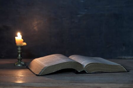Scriptures and candles on a wooden table, golden background, beautiful, religious concepts