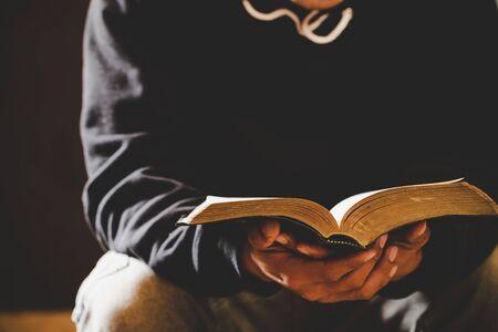 Sunday readings bible, a christian man reading the bible. Stock Photo