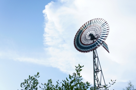 Old wind turbine with beautiful blue sky background  photo