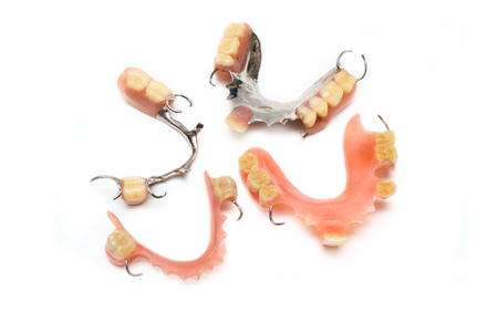 old man real denture with plastic type and stainless steal type.
