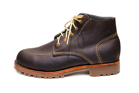 new dark brown color full grain nubuck leather boots with thick anti-slip rubber sole on isolated white background.
